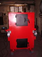 Пиролизный газогенераторный  твердотопливный котел